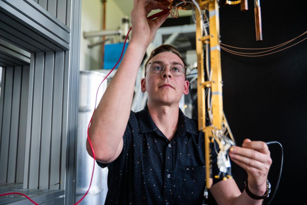 PhD student, Wyatt Vine with equipment